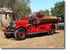 This is a Seagrave antique pumper from Lincoln, CA.
